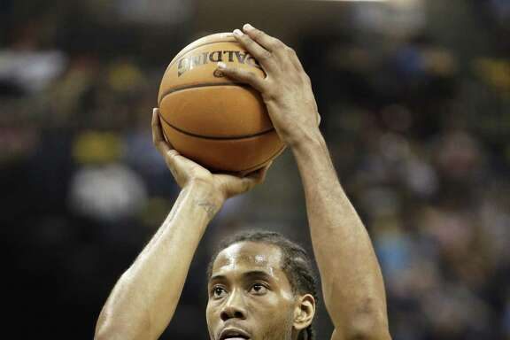 Spurs forward Kawhi Leonard shoots a free throw during the second half of Game 4 in a first-round playoff series against the Memphis Grizzlies on April 24, 2016, in Memphis, Tenn.
