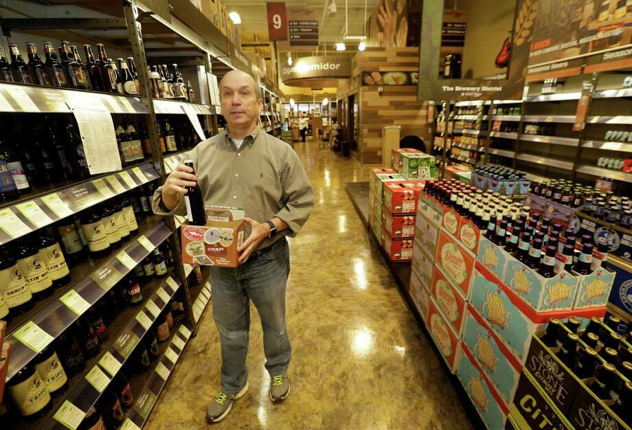 Robert McCormick, district manager, talks about cartons to build your own six-pack at Total Wine, 7640 Cypress Creek Parkway, is shown Tuesday, Oct. 25, 2016, in Houston.  Total Wine is a new-to-market liquor store that will opening soon in the Willowbrook area. ( Melissa Phillip / Houston Chronicle ) Photo: Melissa Phillip, Staff / © 2016 Houston Chronicle