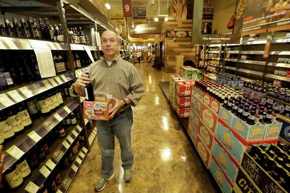 Robert McCormick, district manager, talks about cartons to build your own six-pack at Total Wine, 7640 Cypress Creek Parkway, is shown Tuesday, Oct. 25, 2016, in Houston.  Total Wine is a new-to-market liquor store that will opening soon in the Willowbrook area. ( Melissa Phillip / Houston Chronicle )