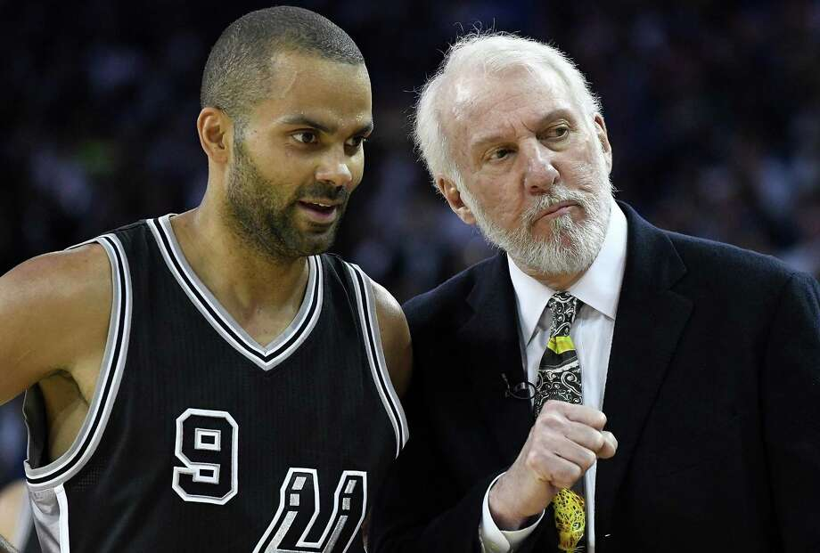 Head coach Gregg Popovich of the Spurs talks with Tony Parker during the fourth quarter against the Golden State Warriors at Oracle Arena on Oct. 25, 2016, at Oakland, Calif. Photo: Thearon W. Henderson /Getty Images / 2016 Getty Images