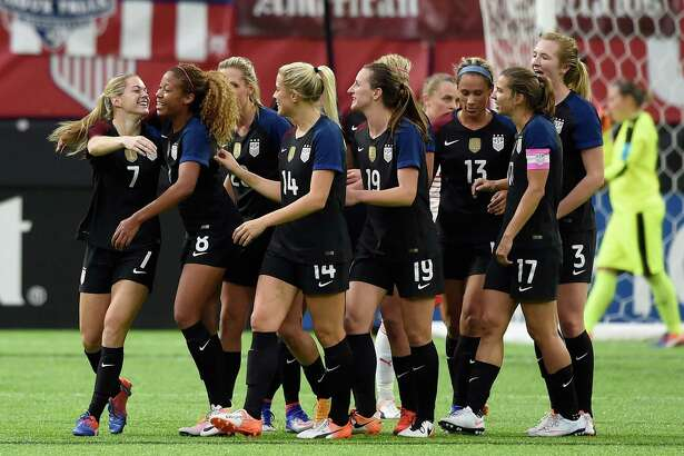 MINNEAPOLIS, MN - OCTOBER 23: The United States congratulate teammate Kealia Ohai #7 on her first goal with the national team against Switzerland during the second half of the friendly match on October 23, 2016 at US Bank Stadium in Minneapolis, Minnesota. The United States defeated Switzerland 5-1.