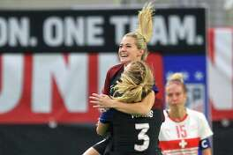 United States' Kealia Ohai (7) is congratulated by teammate Samantha Mewis after scoring a goal in her first appearance with the national team in the second half during an international friendly soccer match against Switzerland, Sunday, Oct. 23, 2016, in Minneapolis. (AP Photo/Andy Clayton-King)