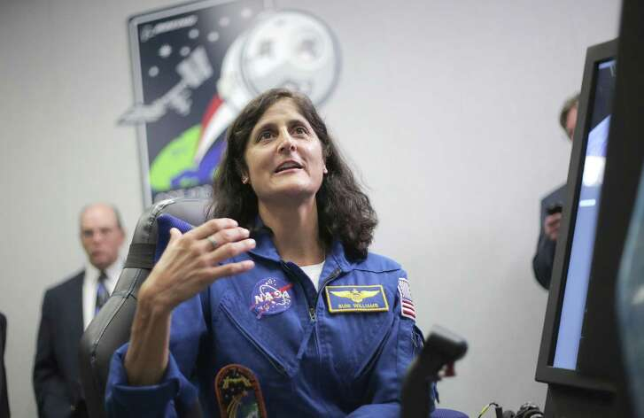 Astronaut Suni Williams talks as she demonstrates a simulator for the Boeing CST-100 Starliner Crew at the Johnson Space Center on Wednesday, Sept. 28, 2016, in Houston. ( Elizabeth Conley / Houston Chronicle )