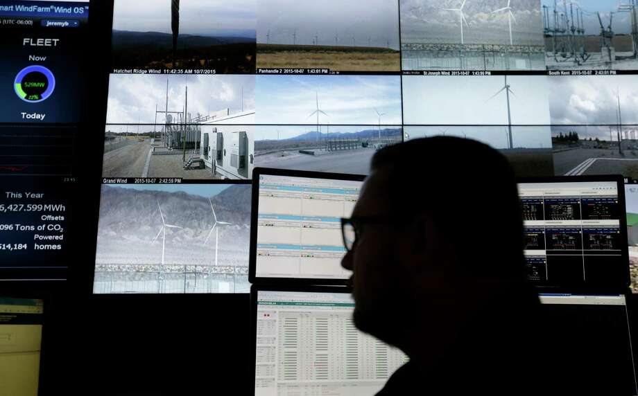 Jeremy Byers , an operations control center operator, keeps an eye on a wind farm operated by Pattern Energy, a firm focused on renewable energy. Photo: Melissa Phillip, Staff / © 2015 Houston Chronicle