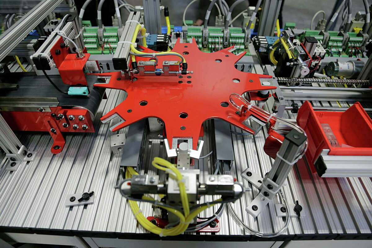 Robotics units are shown at the Robotic Mechatronics lab at Houston Community College's Stafford campus. These gadgets are part of the transformation of Houston's largest industries and examples of how automation could reshape the economy over the next 50 years.