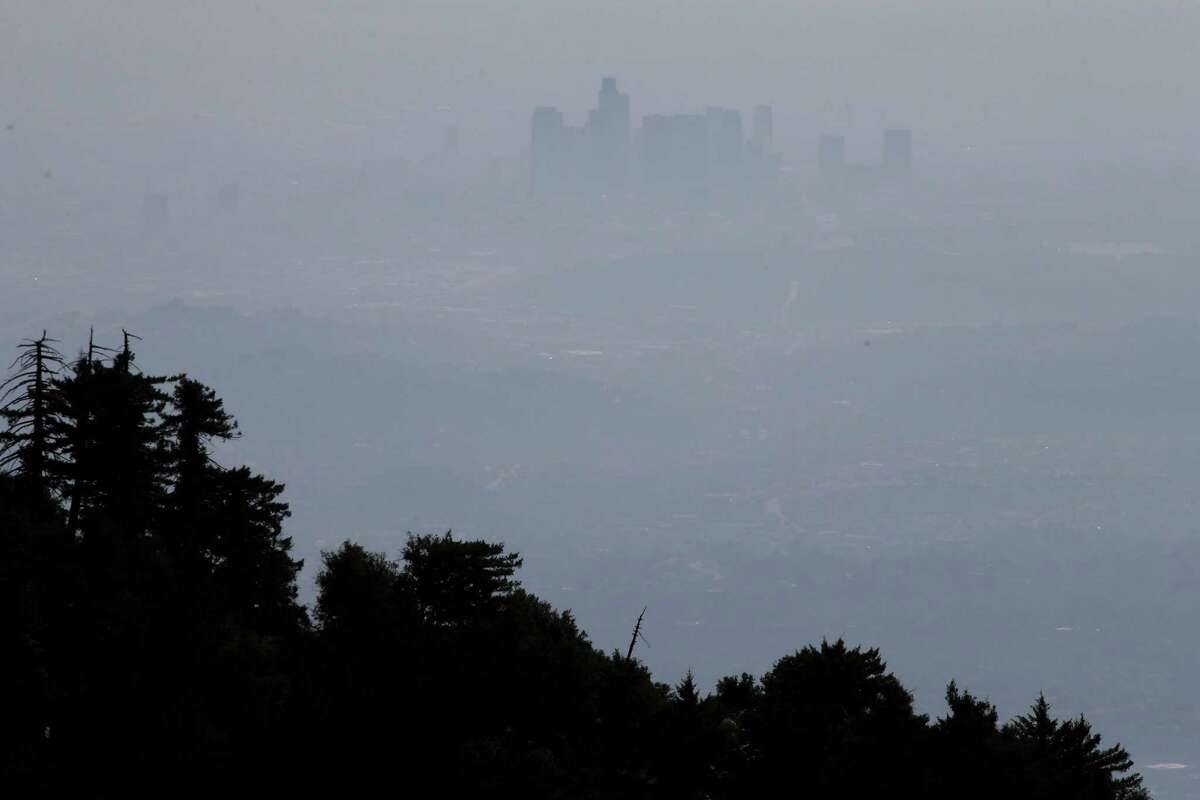 This April 15,2013 file photo shows the hazy skyline of Los Angeles seen from Mount Wilson, Calif. A sensor atop the Los Angeles County mountain has found that methane emissions in the area are up to 61 percent higher than government estimates.