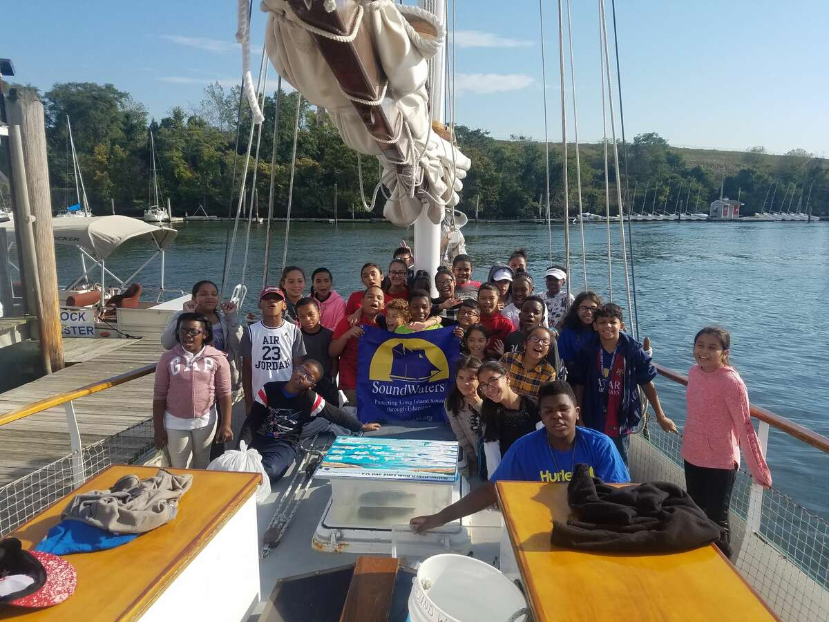 Students in Meghan Esteva's 6th grade science class at Bridgeport's Beardsley School prepare to embark on an educational sail on the schooner, SoundWaters, from Captain's Cove Marina.