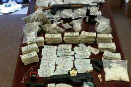 A photo released by the Fort Bend County Sheriff's Office on Oct. 26, 2016 shows items seized during recent raids that led to the arrest of 8 suspected gang members on various charges, including engaging in organized criminal activity, money laundering and delivery of marijuana