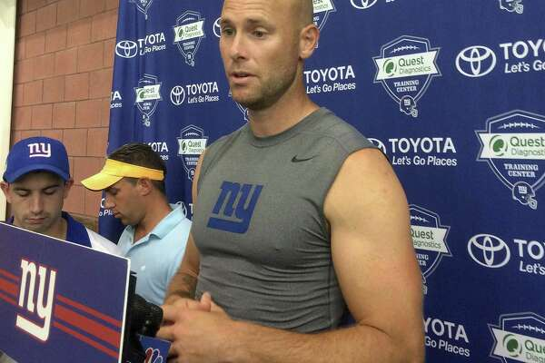 FILE - In this Aug. 18, 2016, file photo, New York Giants kicker Josh Brown speaks with reporters at NFL football training camp, in East Rutherford, N.J. The Giants have released placekicker Josh Brown after police documents revealed Brown had admitted to repeatedly abusing his former wife while they were married. The release came Tuesday, Oct. 25, 2016, shortly after the player issued a statement insisting that he never hit his wife during a six year period when he admits spousal abuse.  (AP Photo/Tom Canavan, File)