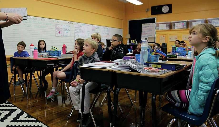 Harvard Elementary School students answered questions on the future of Houston - and while many spoke of a tree-less world of war and hate, there was still optimism. Photo: James Nielsen, Staff / © 2016  Houston Chronicle