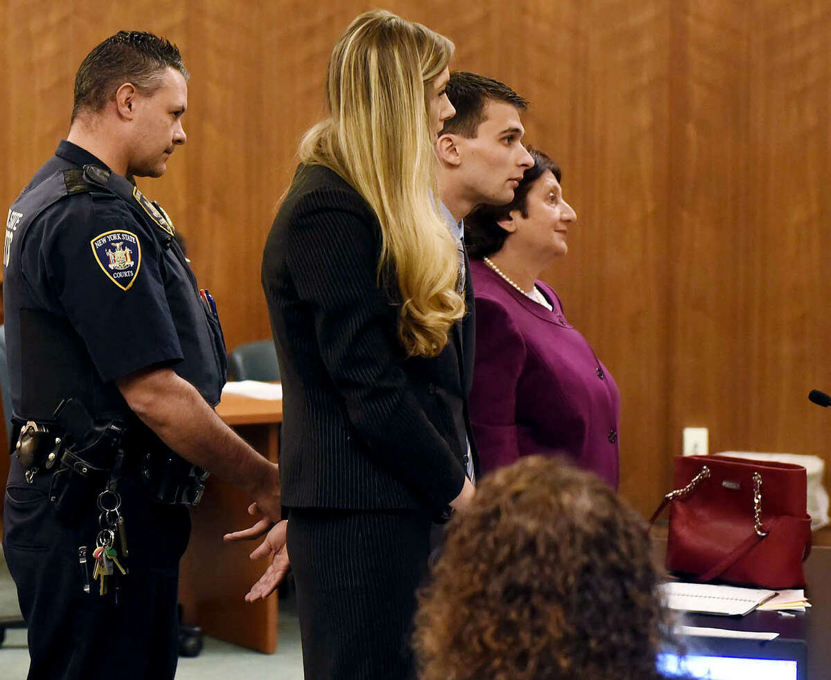 Alexander M. West, center, stands before County Court Judge John Hall during his arraignment at the Warren County Court on Wednesday, Oct. 26, 2016, in Queensbury, N.Y. The boat he was operating July 29 on Lake George struck and killed Charlotte McCue of Carlsbad, Calif., and injured her mother. The young girl, who was to enter the fourth grade, died at the scene. (Ashleigh Abreu/Pool photo)