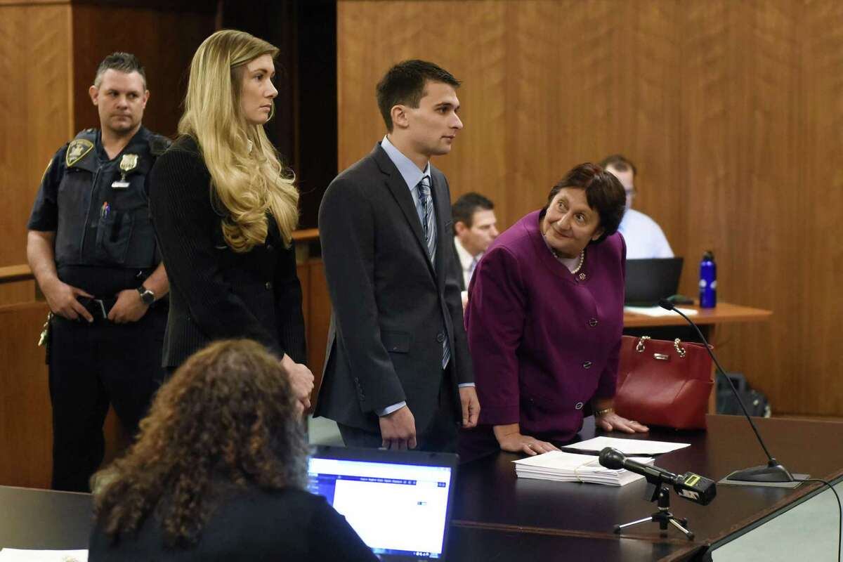 Alexander M. West, center, stands before County Court Judge John Hall as defense attorney Cheryl Coleman, right, looks toward him during his arraignment at Warren County Court on Wednesday, Oct. 26, 2016, in Queensbury, N.Y. Kathryn Conklin, co-council defense, is pictured left. The boat he was operating July 29 on Lake George struck and killed Charlotte McCue of Carlsbad, Calif., and injured her mother. The young girl, who was to enter the fourth grade, died at the scene. (Ashleigh Abreu/Pool photo)