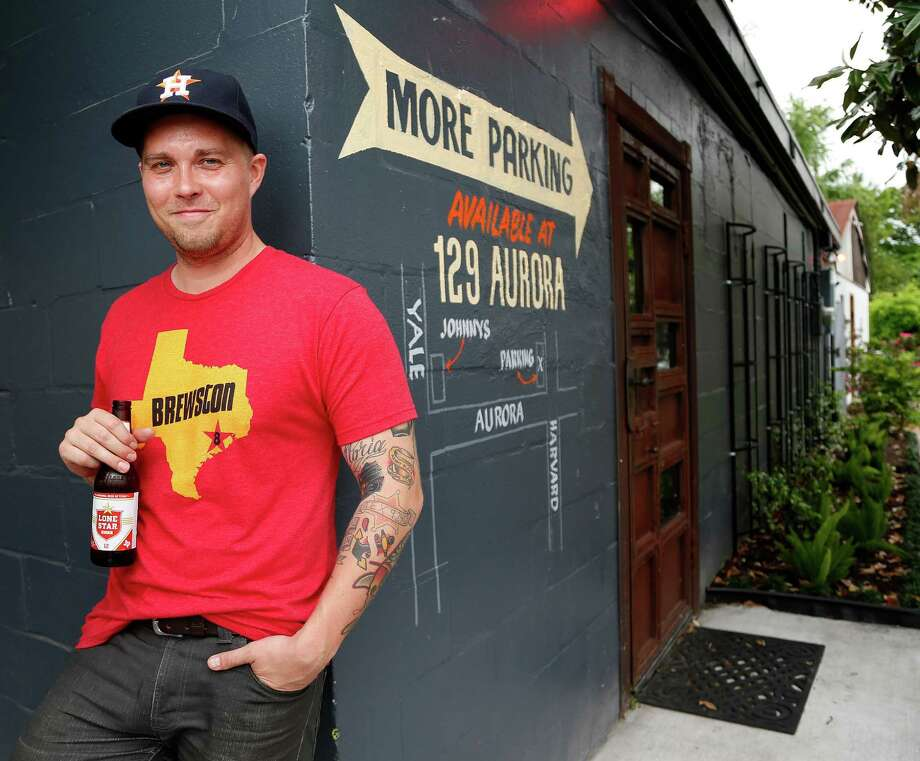 Chris Cusack, head of Treadsack Management, at his bar, Johnny's Gold Brick. Cusack says Houston will always have a seat the table for good food and ambition.  Photo: Karen Warren, Staff / © 2015 Houston Chronicle