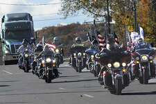 """A truck that displays a replica of the Vietnam Veterans Memorial Wall - called """"the wall that heals"""" - arrives in New Milford by motorcycle escort, Wednesday, Oct. 26, 2016."""