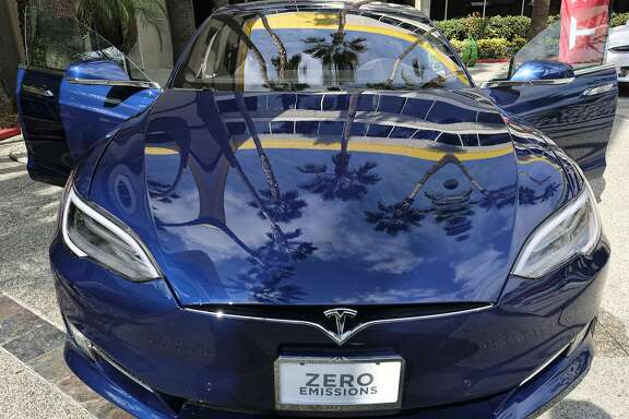This Monday, Oct. 24, 2016, photo shows a Tesla Model S on display in downtown Los Angeles. Tesla Motors reports financial results Wednesday, Oct. 26, 2016. (AP Photo/Richard Vogel)