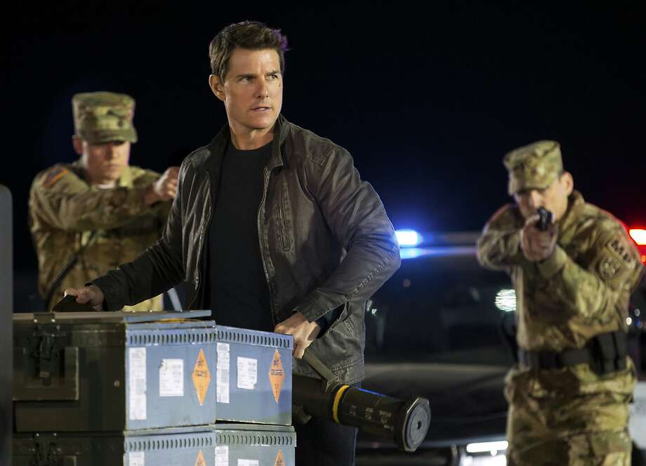 "Tom Cruise — in a shirt and jacket — in ""Jack Reacher: Never Go Back."" Photo: Chiabella James, Associated Press"