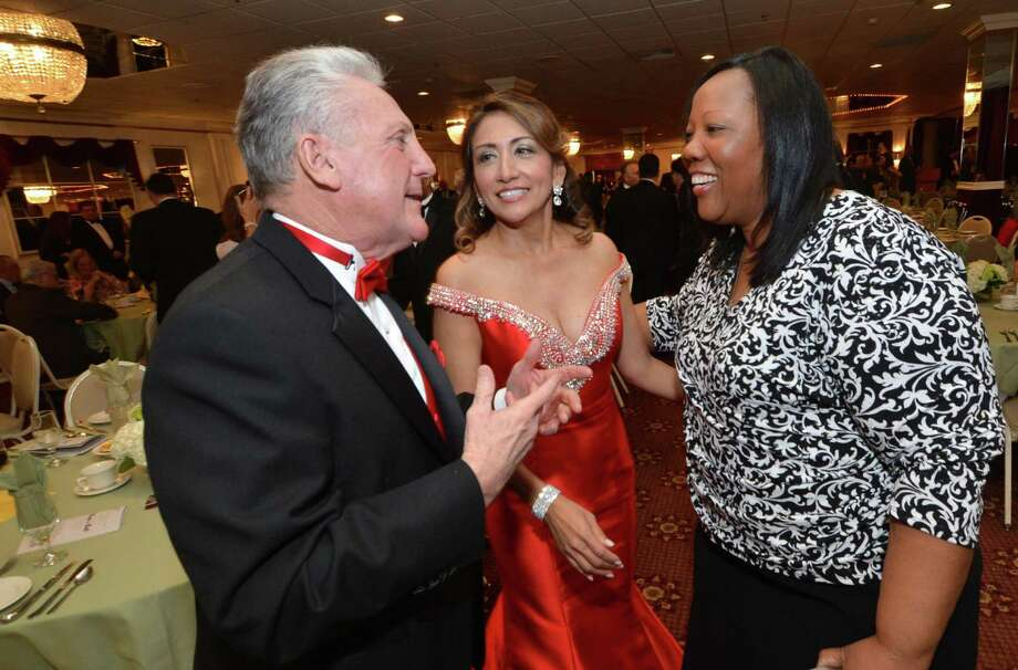 Mayor Harry Rilling and wife Lucia talk with the Carver Center's Novelette Peterkin at the 23rd Annual Mayors Community Ball last year at Continental Manor in Norwalk, Conn. Photo: File Photo / Hearst Connecticut Media File / Norwalk Hour file photo