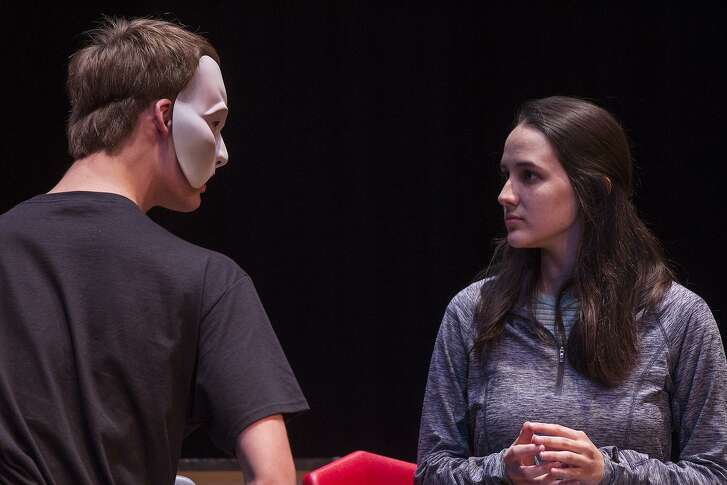 "Travis Anderson, 17, as the Phantom and Ashlyn Prieto, 17, as Christine rehearse ""Phantom of the Opera"" at the North East School of the Arts theater."