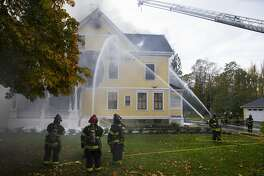 Seattle Fire Department firefighters responded Wednesday afternoon to a fire at a historic home at Seattle's Discovery Park.