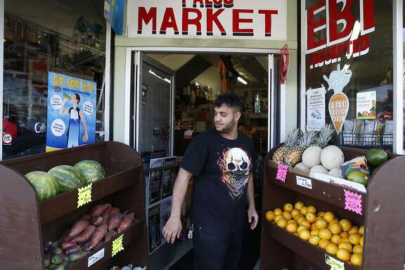 Dowahon Salah, who's uncle owns the Palou Market on Third Street, arranges a produce display at the front door in San Francisco, Calif. on Wednesday, Oct. 26, 2016. Palou Market is one of the first corner stores to participate in the Healthy Retail SF program, which offers incentives to sell produce and other healthy food alternatives.
