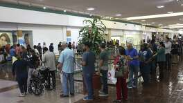 A line forms as people cue up to vote at the Wonderland of the Americas Mall on Tuesday. An increase in the number of people wanting to be poll watchers has been reported this year. This has powder-keg potential, and we urge scrupulous training of watchers.