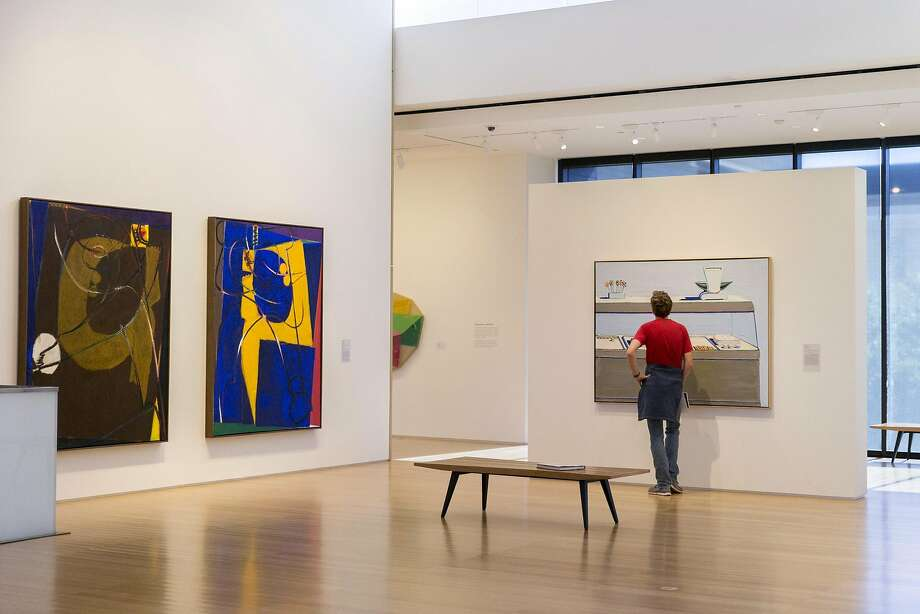 """Matthew Vollrath, a Stanford student, checks out """"Candy Counter"""" (1962) by Wayne Thiebaud at the Anderson Collection. Photo: Santiago Mejia, The Chronicle"""