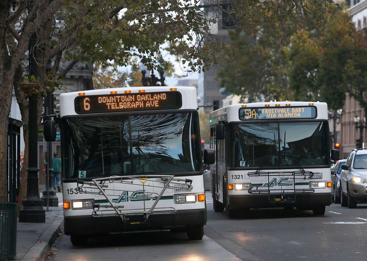 AC Transit buses drive on Broadway near City Hall in Oakland, Calif. on Wednesday, Oct. 26, 2016. Measure C1 on the Alameda County ballot is one of several tax proposals that Bay Area voters will consider to support public transportation.