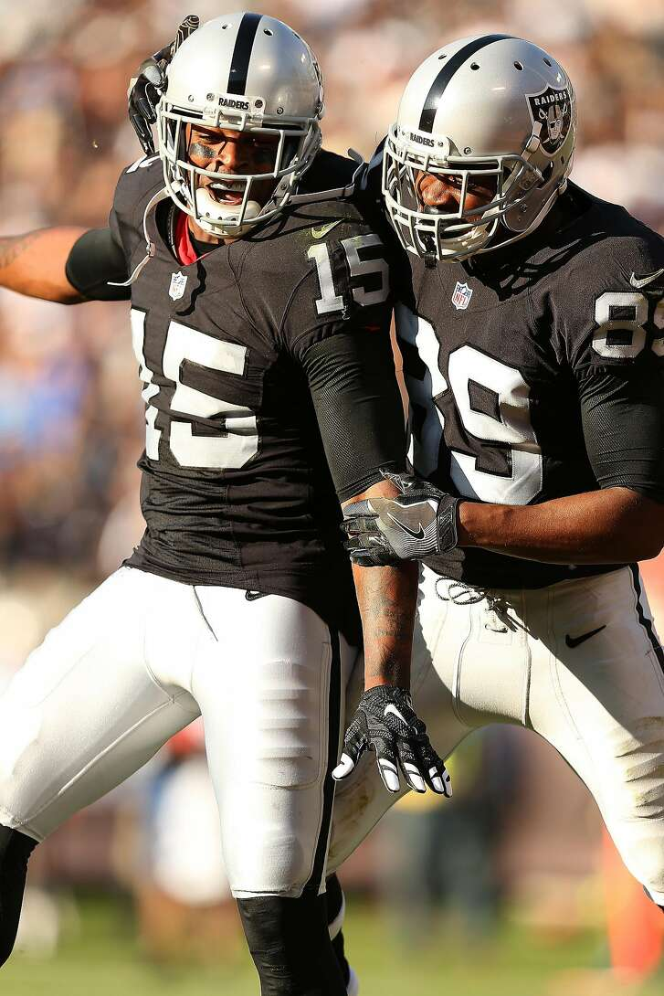 Oakland Raiders wide receivers Michael Crabtree (15) and Amari Cooper (89) celebrate a touchdown during an NFL football game against the Tennessee Titans Saturday, Aug. 27, 2016, in Oakland, CA. The Titans beat the Raiders 27-14. (Daniel Gluskoter/AP Images for Panini)