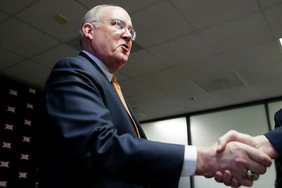 Texas Athletic Director Mike Perrin shakes hands after the Big 12 conference meeting Thursday, Feb. 4, 2016, in Irving, Texas. (AP Photo/LM Otero)