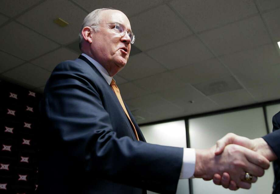 Texas Athletic Director Mike Perrin shakes hands after the Big 12 conference meeting Thursday, Feb. 4, 2016, in Irving, Texas. (AP Photo/LM Otero) Photo: LM Otero, STF / AP