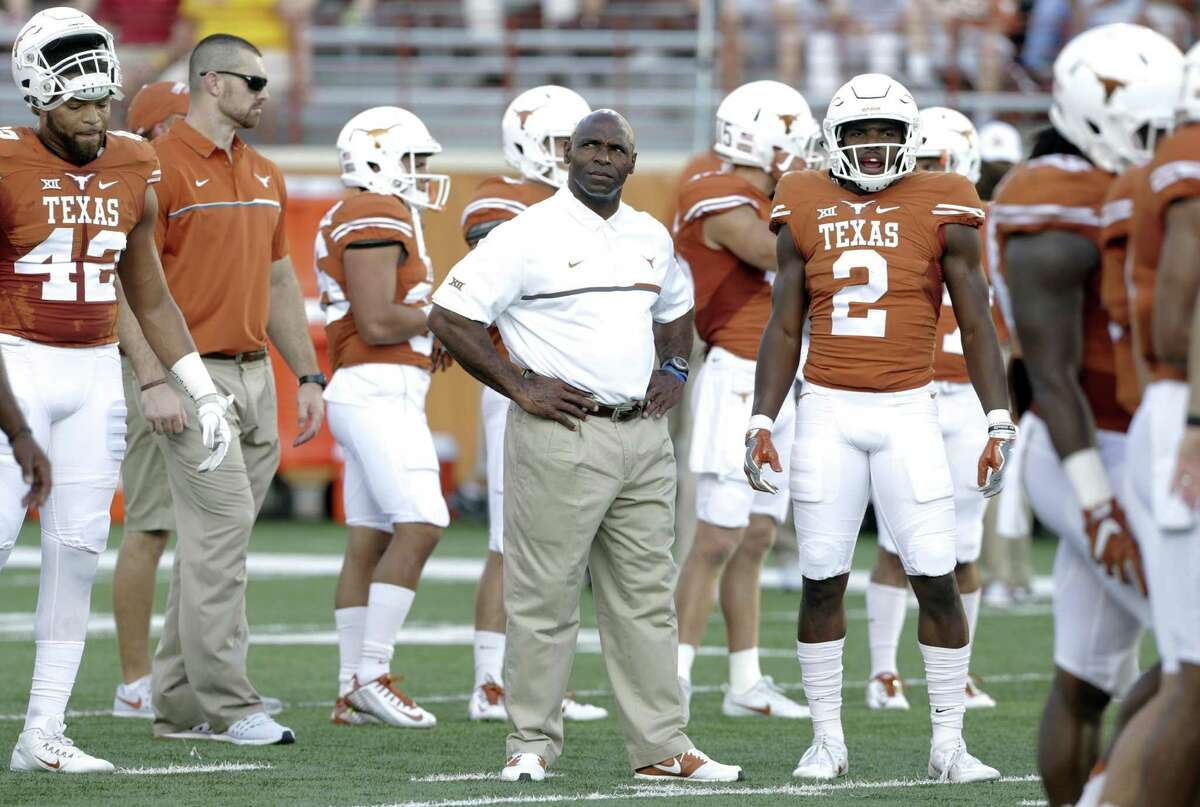 Texas coach Charlie Strong waits among his players for the start of the game against Iowa State at Royal-Memorial Stadium on Oct. 15, 2016.