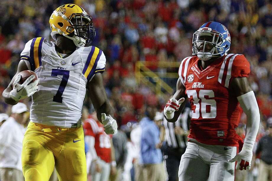 BATON ROUGE, LA - OCTOBER 22:  Leonard Fournette #7 of the LSU Tigers runs past Zedrick Woods #36 of the Mississippi Rebels for a 76-yard touchdown during the first half of a game at Tiger Stadium on October 22, 2016 in Baton Rouge, Louisiana.  (Photo by Jonathan Bachman/Getty Images) Photo: Jonathan Bachman, Stringer / 2016 Getty Images