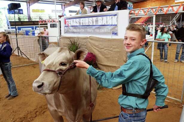 Chase Anderson of Tarkington Jr. FFA sold his Grand Champion Market Steer for $16,000 to WEG Group and Bill Sjolander at the TVE Youth Livestock Auction on Oct. 21.