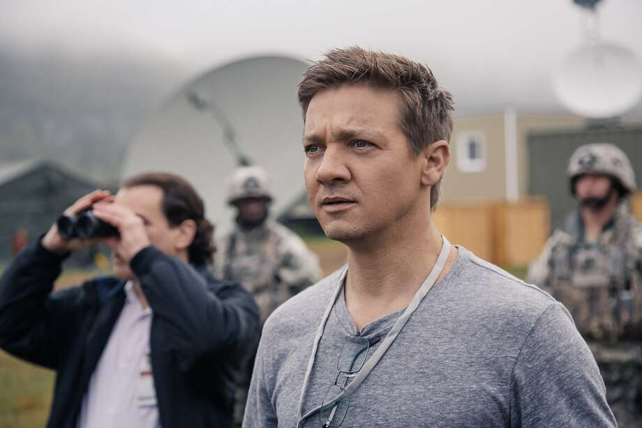"""Above: Jeremy Renner in the science fiction drama """"Arrival."""" At right: Amy Adams. Photo: Paramount Pictures"""