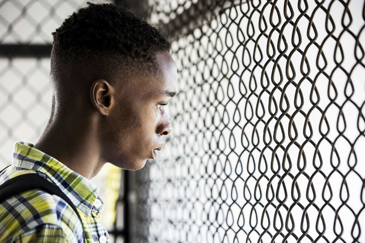 """In this image released by A24 Films, Ashton Sanders appears in a scene from """"Moonlight."""" (David Bornfriend/A24 via AP)"""