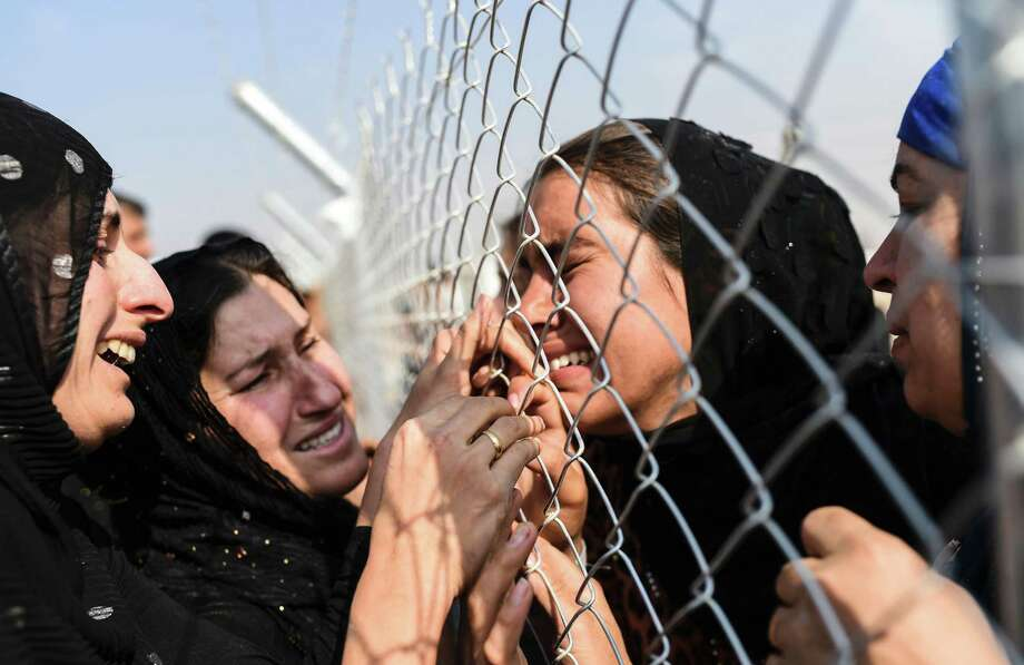 Newly displaced Iraqis who fled from Mosul meet their relatives who came two years ago to the refugee camp near near the Kurdish checkpoint of Aksi Kalak. Photo: BULENT KILIC, Staff / AFP or licensors
