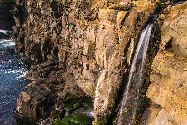 FORT ROSS, CA - FEBRUARY 10: A waterfall flows again after recent heavy rains on the Sonoma Coast near Salt Point State Beach February 10, 2016, near Fort Ross, California. Much of Southern California has entered a fifth year of drought, but the irrigation ponds and reservoirs in Sonoma County Wine Country are filled once again and the grapevines are expected to come alive this week due to recent warm weather. (Photo by George Rose/Getty Images)