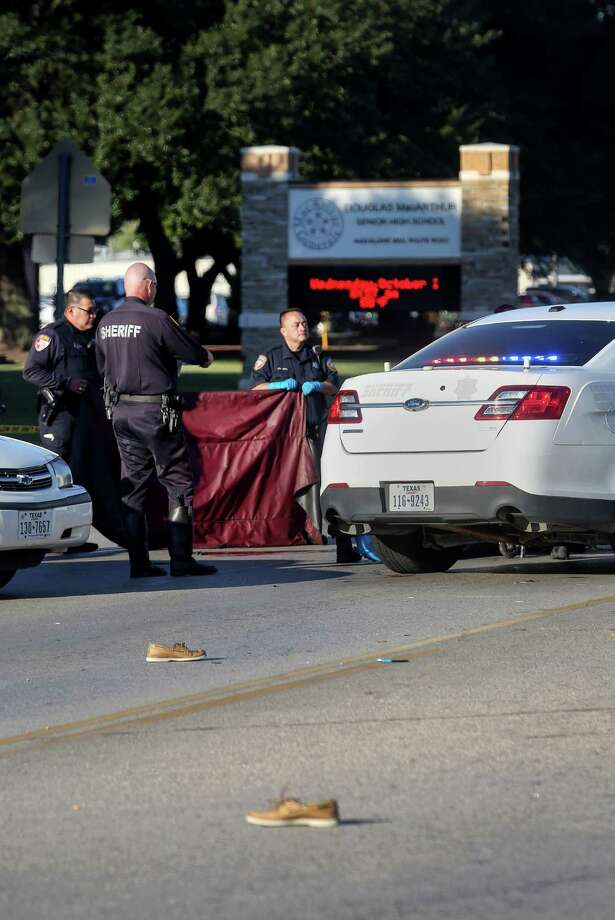 Authorities investigate a crash that killed Jose Torres, 18, as he was crossing Aldine Mail Route on his way to MacArthur High Wednesday. Photo: Jon Shapley, Staff / © 2015  Houston Chronicle