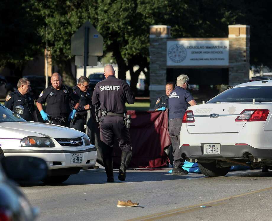 Authorities investigate a fatal accident that killed Jose Torres, 18, as he was crossing Aldine Mail Route on his way to MacArthur High School, Wednesday, Oct. 26, 2016, in Houston.  ( Jon Shapley / Houston Chronicle ) Photo: Jon Shapley, Staff / © 2015  Houston Chronicle