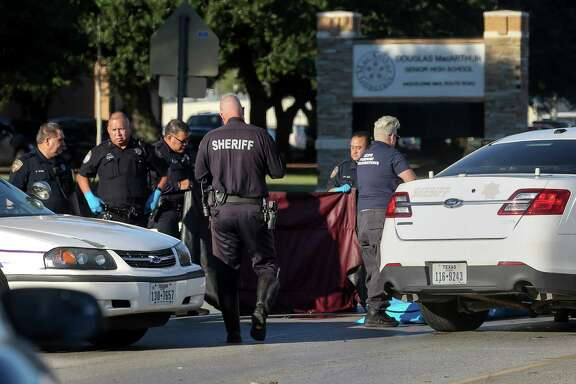 Authorities investigate a fatal accident that killed Jose Torres, 18, as he was crossing Aldine Mail Route on his way to MacArthur High School, Wednesday, Oct. 26, 2016, in Houston.  ( Jon Shapley / Houston Chronicle )