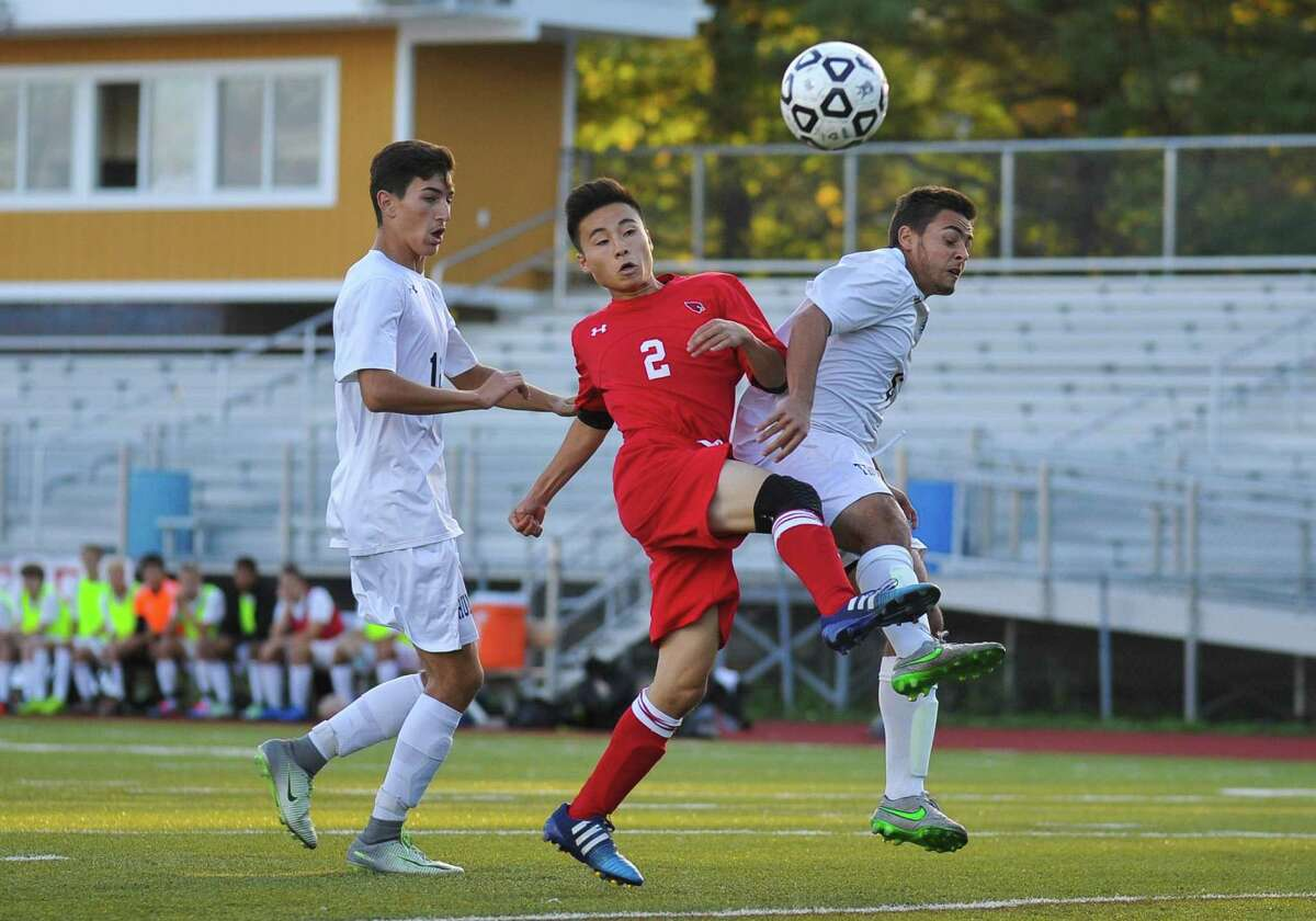 Shoki Araki (2) of the Greenwich Cardinals takes a shot during a game against the Trumbull Eagles on October 4, 2016 at Trumbull High School in Trumbull, Connecticut.