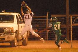 Abernathy receiver Kole Carlisle, 21, makes a leaping catch against Floydada as the Whirlwinds' Abraham Perez, 20, defends during a District 2-2A football game last week. Abernathy will take on New Deal in a battle of district unbeatens in Abernathy Friday.