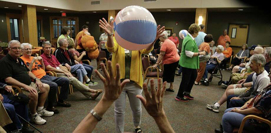 Beach balls being bounce around at the Interfaith Care Partners outreach session for Alzheimer's and other disabled people during an entertaining day of arts/crafts activities at Lakewood United Methodist Church Oct. 10, 2016, in Spring. ( James Nielsen / Houston Chronicle ) Photo: James Nielsen, Staff / Houston Chronicle / © 2016  Houston Chronicle
