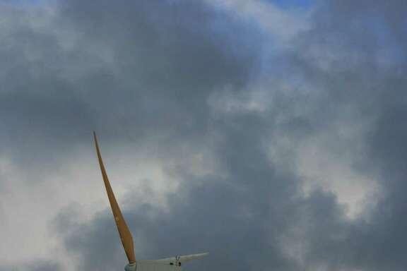 Bill Montgomery  /  Houston Chronicle  The Hawi Renewable Development Wind Farm near Upolu Point on the Big Island of Hawaii consists of 16 turbines. EnXco and Hawi Renewable Development started generating power at the 10.6-megawatt wind farm in 2006.