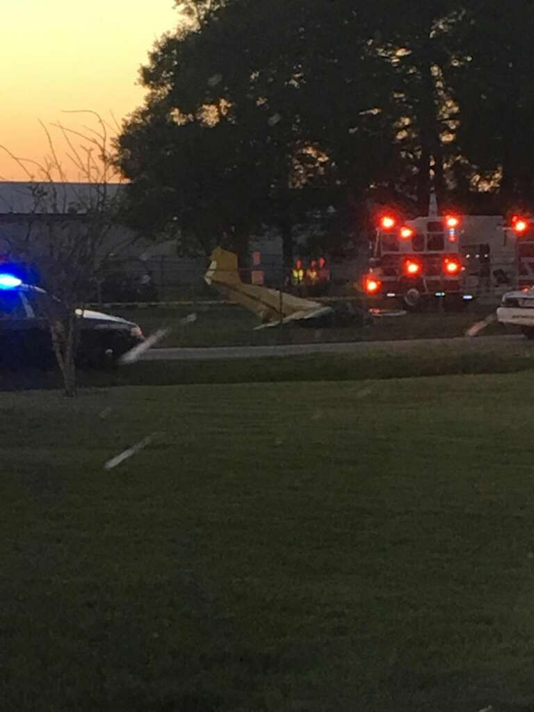 Emergency crews work the scene of the plane crash at Pearland Regional Airport on Wednesday. Photo: Elizabeth Vann