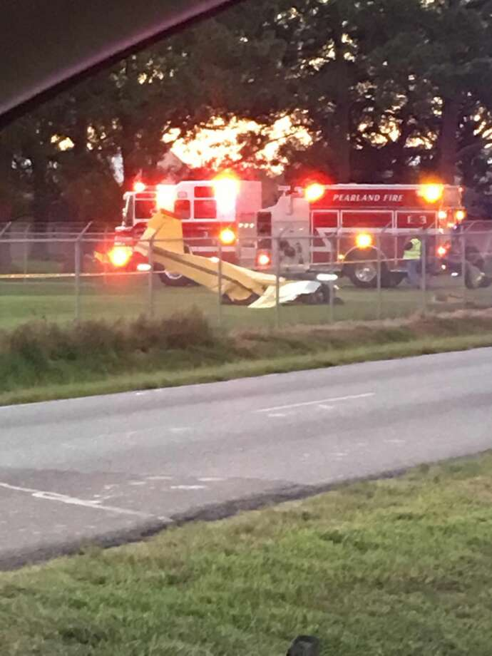 Emergency crews work the scene of the plane crash at Pearland Regional Airport on Wednesday. Photo: Elizabeth Vann