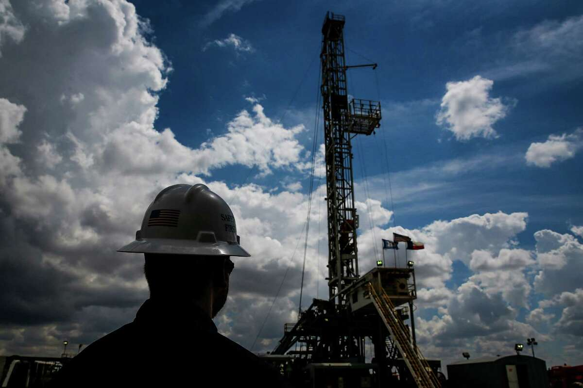 A Diamondback Energy rig drills for oil and gas in September outside of Midland. Almost 300 rigs are drilling in the area now, more than double the number in May.