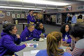 Members of the UAlbany womens basketball team wait to be interviewed during UAlbany basketball media day on Wednesday Oct. 26, 2016 in Albany, N.Y.  (Michael P. Farrell/Times Union)