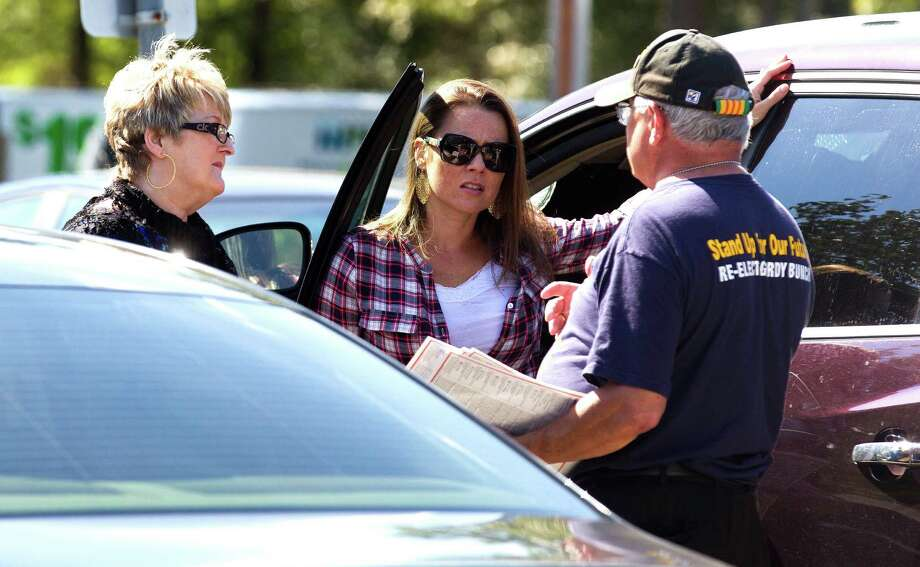 A Gordy Bunch supporter talks with voters at the early voting location at the South County Community building Wednesday, Oct. 26, 2016, in The Woodlands. Board member Bunch is running for re-election for Position 1 with The Woodlands Township against Amy Lampman and Bob Leilich. Photo: Jason Fochtman, Staff Photographer / Houston Chronicle