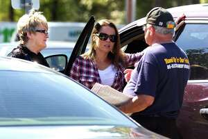 A Gordy Bunch supporter talks with voters at the early voting location at the South County Community building Wednesday, Oct. 26, 2016, in The Woodlands. Board member Bunch is running for re-election for Position 1 with The Woodlands Township against Amy Lampman and Bob Leilich.